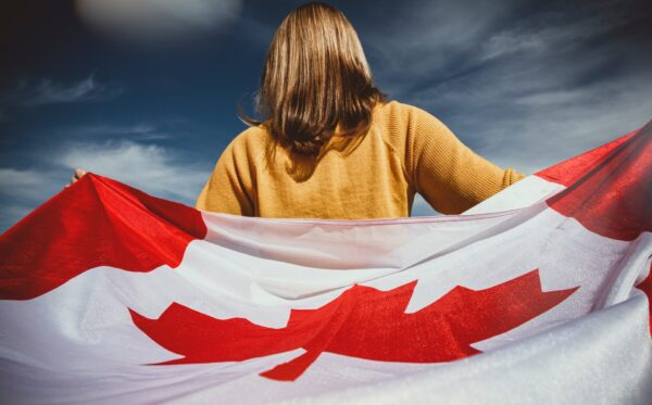 woman-holding-canada-flag-2960861